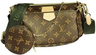 Louis Vuitton Multi Pochette Accessoires Beige Cloth Clutch bags