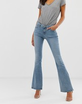 Asos Design DESIGN Mid rise flare jeans in light wash blue