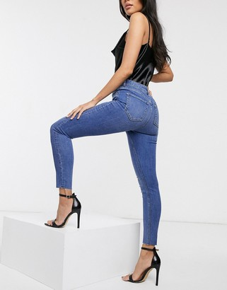 Asos DESIGN Ridley high waisted skinny jeans in mid blue