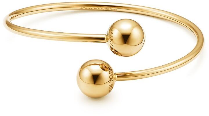 Tiffany & Co. City HardWear ball bypass bracelet in 18k gold, medium