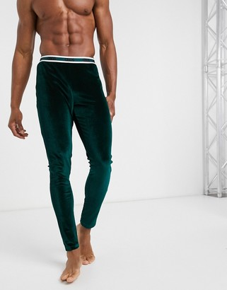 ASOS DESIGN lounge pyjama meggings in green velour fabric with branded waistband