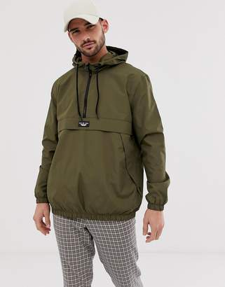 Bershka overhead windbreaker jacket with half zip in khaki-Green