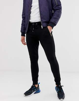 Asos Design DESIGN super skinny joggers with gold zips in black