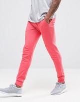 Asos Super Skinny Joggers In Pink Marl