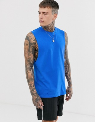 Asos Design DESIGN pique relaxed sleeveless t-shirt with dropped armhole in blue