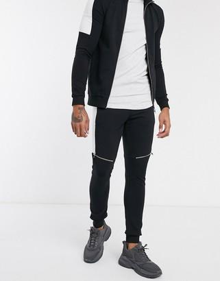 ASOS DESIGN two-piece skinny sweatpants with split side stripe & zip details in black