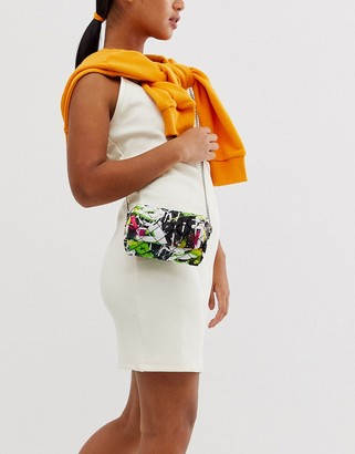 Asos Design DESIGN quilted stud cross body bag in grafitti print-Multi