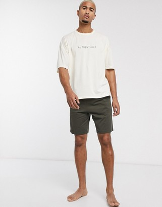 Asos DESIGN lounge pyjama set with oversized tshirt and short in stone with authentique slogan