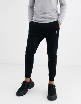 Religion skinny fit logo sweatpants in black