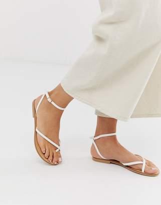 Asos Design DESIGN Freefall minimal toe loop flat sandals in white