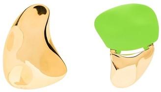 Monica Sordo Gilot mismatched earrings