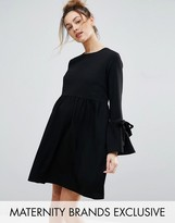 Queen Bee Smock Dress With Bell Sleeve And Tie Detail