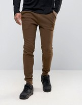 Asos Super Skinny Joggers In Brown