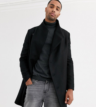 Religion tall funnel neck asymmetric overcoat in black