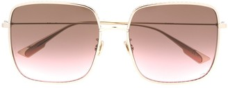 Christian Dior by oversized sunglasses