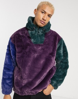 ASOS DESIGN oversized faux fur colour block hoodie with high neck in deep purple green & blue