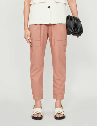 Brunello Cucinelli Embellished tapered high-rise cotton trousers