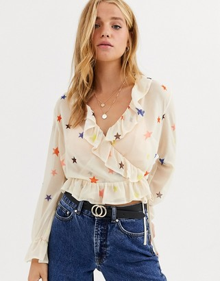 Nobody's Child wrap front blouse with ruffle sleeve in star print