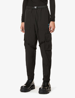 Off-White Tapered logo-print cotton and shell-blend cargo trousers
