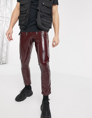 ASOS DESIGN stretch slim jeans in burgundy vinyl with zip front
