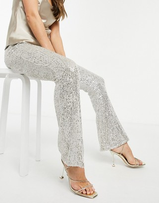ASOS DESIGN sequin flared pants in silver