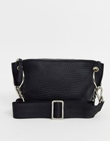 Asos Design DESIGN LEATHER winged cross body bag with ring chain detail