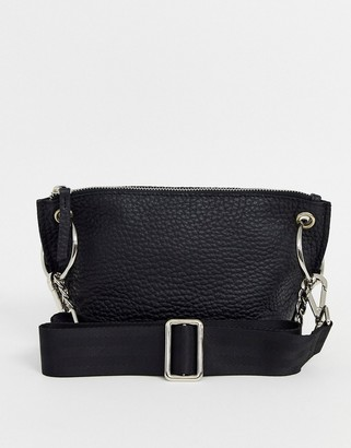 ASOS DESIGN LEATHER winged cross body bag with ring chain detail