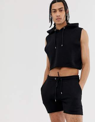 Asos Design DESIGN crop sleeveless tracksuit with hoodie and shorter length shorts in black with raw hems