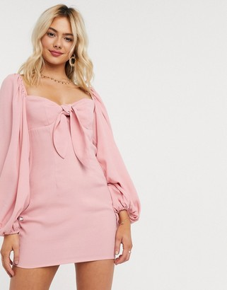 In The Style x Lorna Luxe puff sleeve off shoulder tie front mini dress in pink