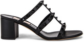 Valentino Rockstud Mules in Black & Black | FWRD