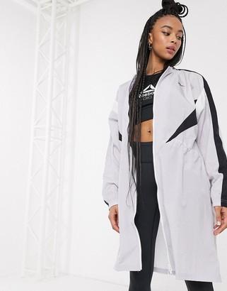 Reebok Training long woven jacket in gray
