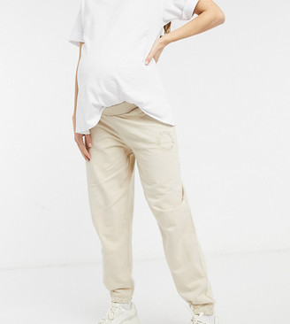 ASOS DESIGN Weekend Collective Maternity co-ord washed oversized trackies with logo in stone