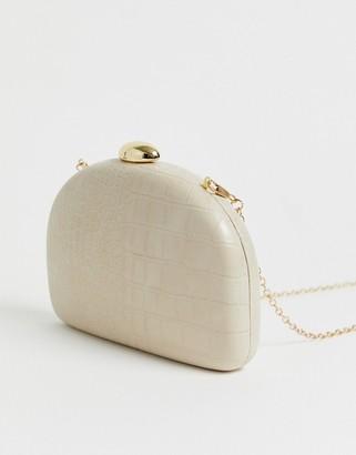 True Decadence Exclusive half moon cross body bag in cream mock croc