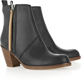 Pistol leather ankle boots with brown wooden heel