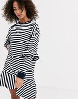 Asos Design DESIGN ruffle sweat mini dress in black and white mono stripe