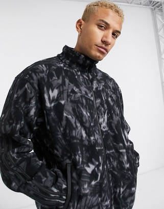 adidas fleece jacket with all over print and reflective details tech pack