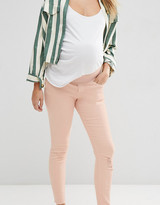 Asos Ridley Skinny Jeans In Petal Pink Wash With Rip And Repair With Under The Bump Waistband