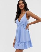 Asos Design DESIGN mini smock sundress with tiered hem in blue