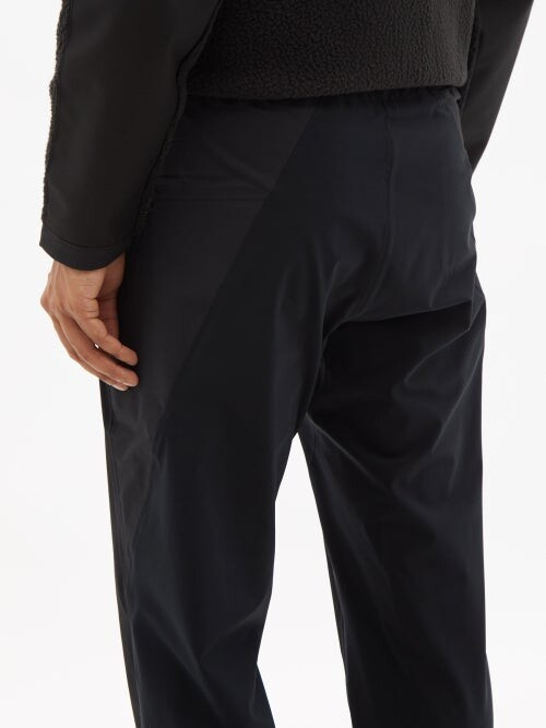 Thumbnail for your product : Veilance Secant Panelled Technical-shell Tapered Trousers - Black