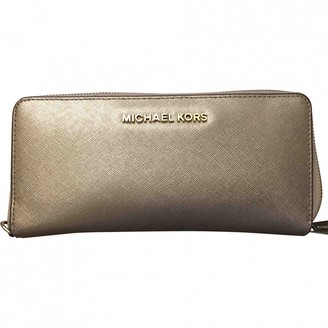 Michael Kors Jet Set Gold Leather Wallets