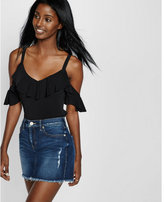 Express mid rise medium wash denim mini skirt