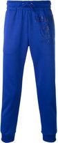 Moschino printed jogger sweatpants - men - Polyester/Cotton - XS