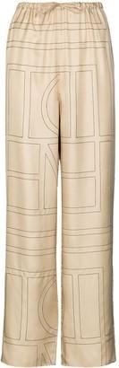Totême Vizelle monogram-print trousers