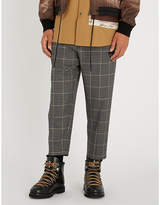 Oamc Checked-pattern tapered wool trousers