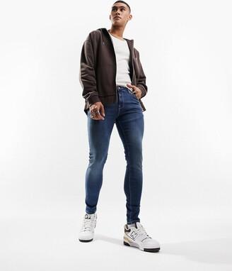 ASOS DESIGN spray on jeans with power stretch in dark wash blue