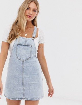 Stradivarius denim pinafore dress in blue