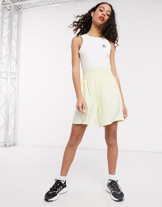 adidas adicolor satin look shorts in yellow