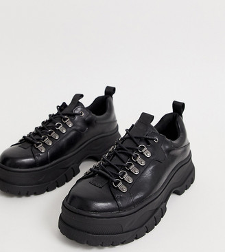 Asos DESIGN Wide Fit trainer shoes in black faux leather with chunky sole