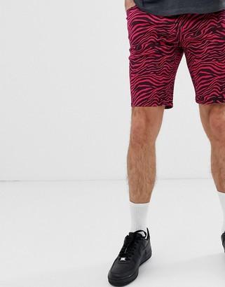 ASOS DESIGN skinny denim shorts in pink zebra print