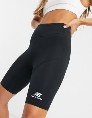 New Balance short leggings with metallic logo in black